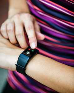person in black smartwatch